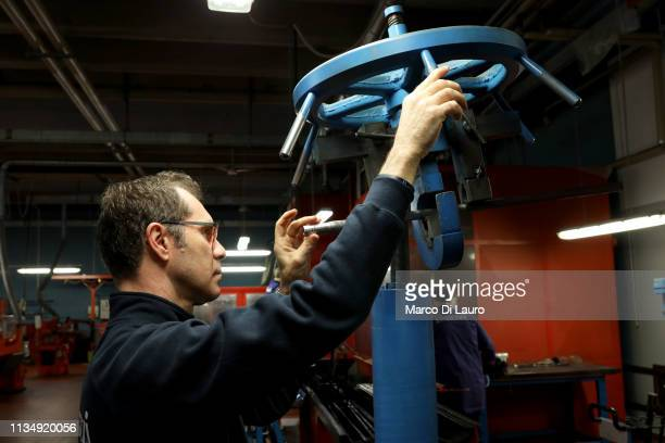 A technician checks a steel bar that has just been bored to be transformed into a gun barrel on April 4 2019 at the Perazzi Armi factory in Botticino...
