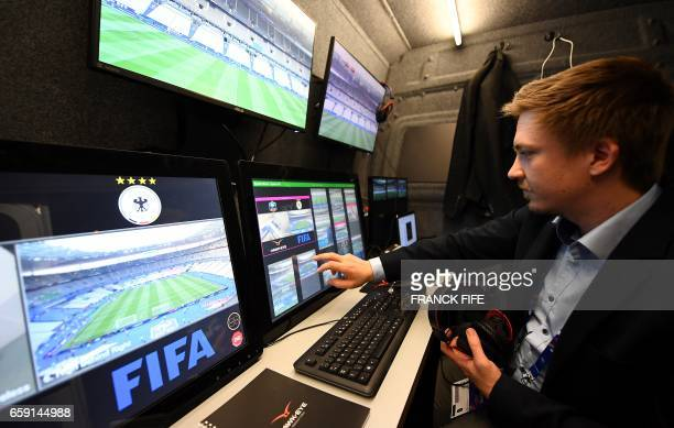A technician checks the video arbitration system that will be used during the friendly football match France vs Spain on March 28 2017 at the Stade...