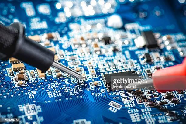 Technician checks the voltage