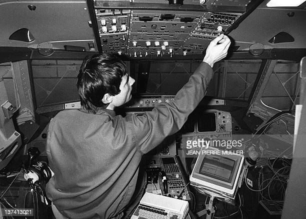 A technician controls the equipment of the cockpit of the new Airbus A320 airliner in the buildings of Aerospatiale 24 February 1987 in Toulouse The...