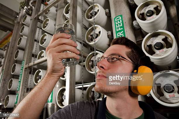 Technician Does Quality Check in Reverse Osmosis Water Purification Plant