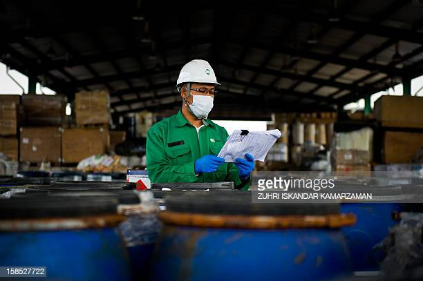 Technician / engineer inspecting chemical waste at a plant.