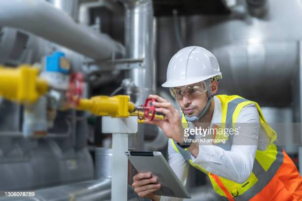 technician engineer working in industrial plant by checking valve pipe - repairing stock pictures, royalty-free photos & images