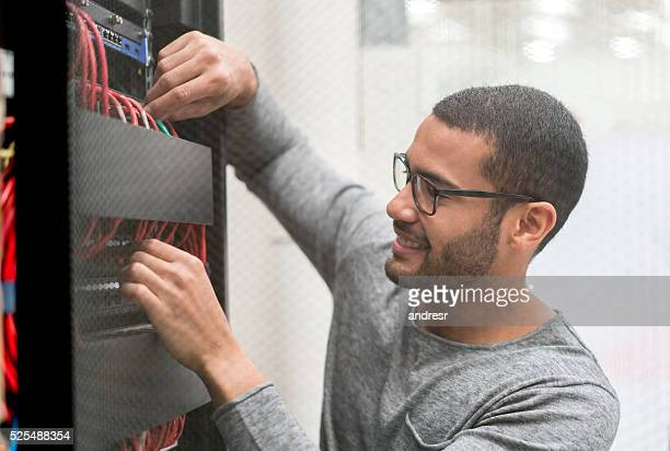 IT technician fixing a server at the office