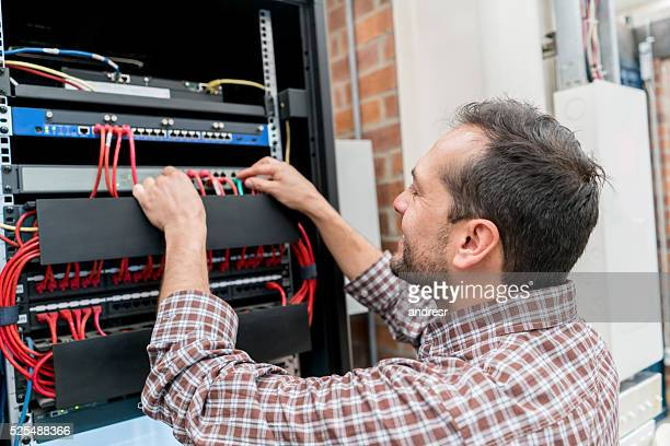 IT technician fixing cables at the office