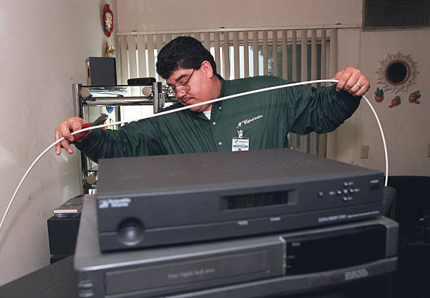 Technician Francisco Aceves (cq) of Charter Communications installs ...