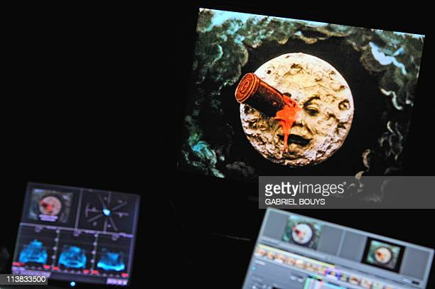 RAYNALDYA technician from Technicolor works on April 21 2011 on the restoration of the 1902 movie Le voyage dans la lune by French director Georges...