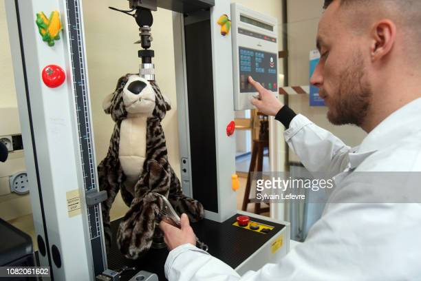 A technician from the Lille Customs Laboratory tests resistance on a soft toy on December 13 2018 in Villeneuved'Ascq France