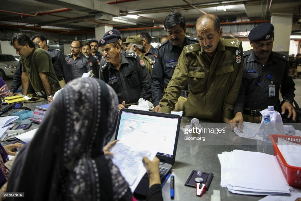 A technician front collect samples for forensic tests at the Punjab Forensic Science Agency in Lahore Pakistan on Thursday June 15 2017 While...