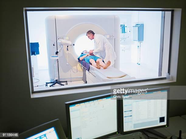 Technician giving patient MRI examination
