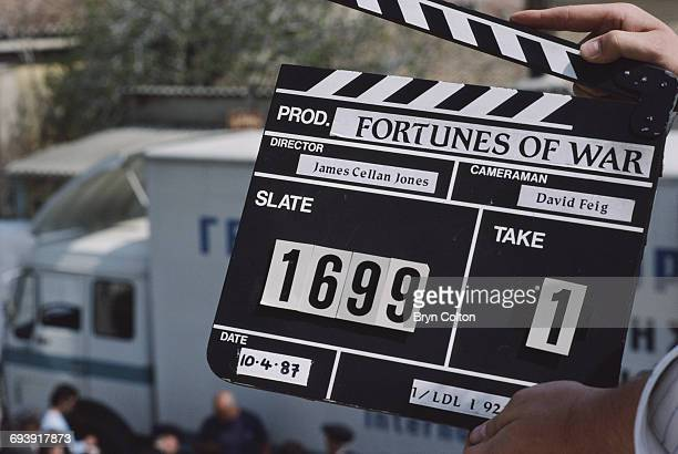 A TV technician holds a 'clapper board' to indicate the start of filming for the new BBC drama series 'Fortunes of War' whilst on location near...