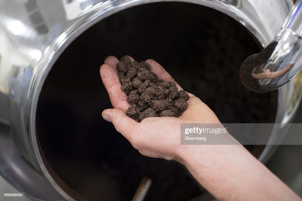 A technician holds hazlenut and chocolate mix 'gandujas' during manufacture at the Barry Callebaut AG Institute in Wieze, Belgium, on Wednesday, Dec. 16, 2016. The 3-D printing process can cut down the time and effort in crafting desired products, while expanding design possibilities that may be too intricate for human hands. Photographer: Jasper Juinen/Bloomberg via Getty Images