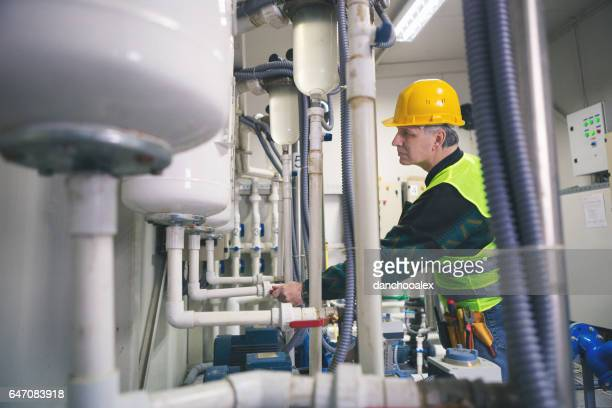 Technician in a boiler room