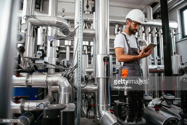 Technician in a boiler room