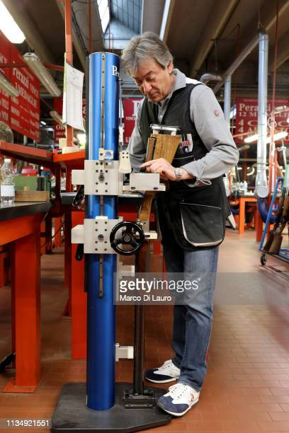 A technician in charge of customer service takes measurements for a client on April 4 2019 at the Perazzi Armi factory in Botticino Mattina a village...