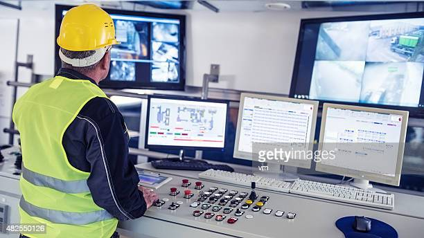 technician in control room - surveillance stock pictures, royalty-free photos & images