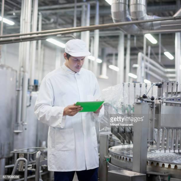 Technician in ice cream factory