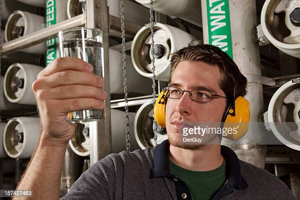 Technician in Reverse Osmosis Water Purification Plant Checks Quality
