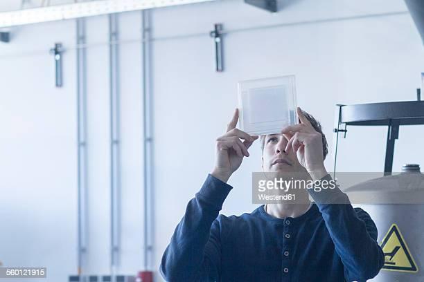 Technician in workshop examining sample