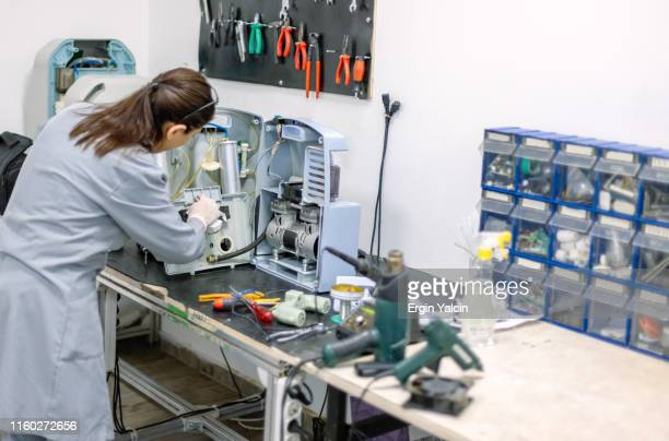 technician in workshop - medical equipment stock pictures, royalty-free photos & images