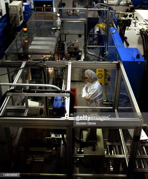 A technician inside a NYPRO clean room high precision work