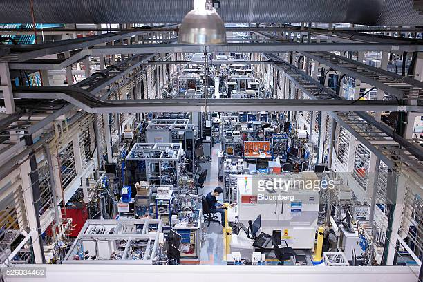 A technician inspects equipment inside the main production and testing area at the Ballard Power Systems Inc facility in Burnaby British Columbia...