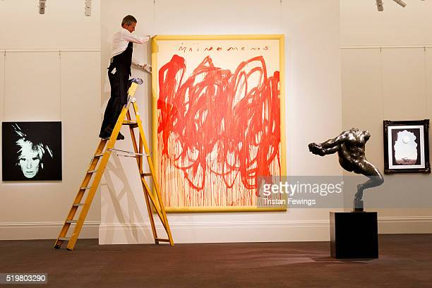A technician installs Cy Twombly's Untitled 2004 at Sotheby's on April 8 2016 in London England The work will be sold as part of Sotheby's...