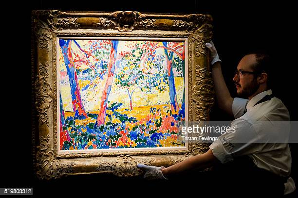 A technician installs Maurice De Vlaminck's SousBois 1905 at Sotheby's on April 8 2016 in London England The work will be sold as part of Sotheby's...