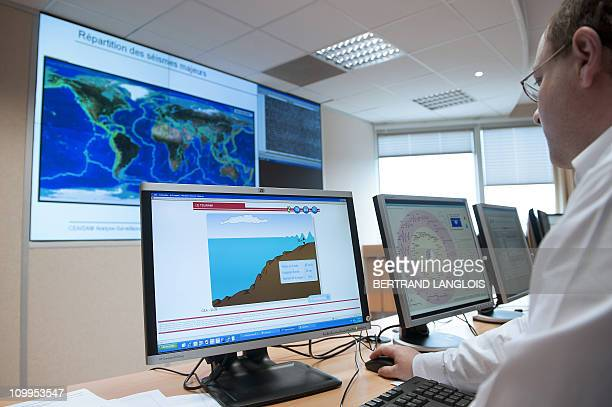 A technician is at work on March 11 at the French Tsunami Warning Center of the CEA in BruyeresleChatel south of Paris as an oceanwide alert has been...