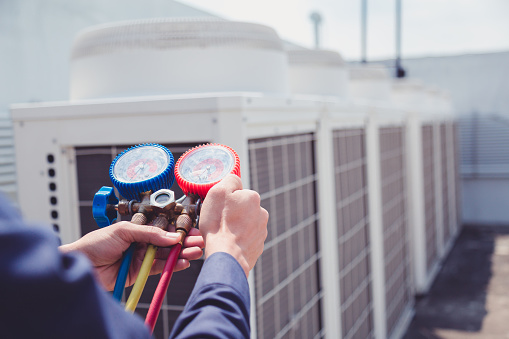 Technician is checking air conditioner ,measuring equipment for filling air conditioners. 960461794