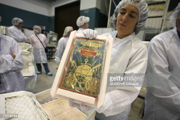 CAMBRELENG A technician is packs Jules Verne's manuscript to go into space with the next mission at the Thales Alenia Space center on 03 October 2007...