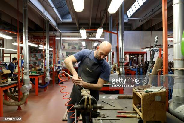 A technician is seen at work on a stock on April 4 2019 at the Perazzi Armi factory in Botticino Mattina a village in the outskirt of the city of...