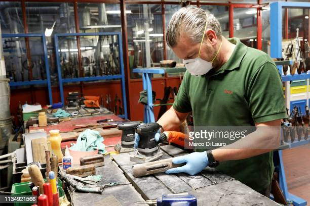 A technician is seen at work on April 4 2019 at the Perazzi Armi factory in Botticino Mattina a village in the outskirt of the city of Brescia Italy...
