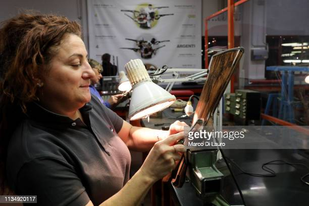 A technician is shown chequering a shotgun stock on April 4 2019 at the Perazzi Armi factory in Botticino Mattina a village in the outskirt of the...