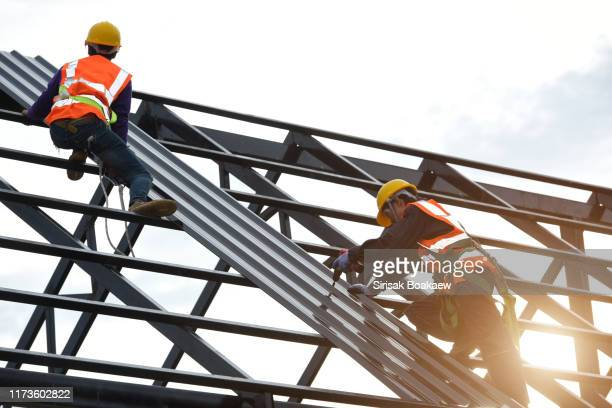 technician is work roof repair construction engineer - roof stock pictures, royalty-free photos & images