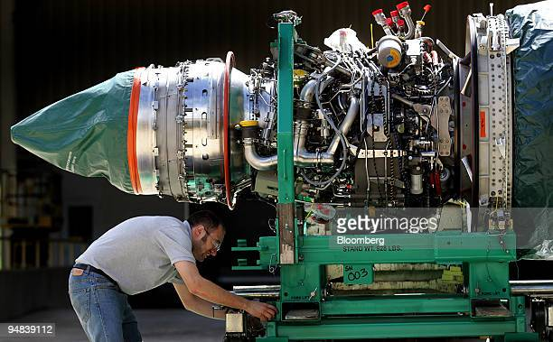 Technician Lloyd Schils loads a General Electric Co GE90115B jet engine specifically designed for the Boeing 777 for shipping outside the company's...