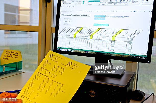 A technician looks at transfer results for steroid profiles in the database 'Adams' World AntiDoping Agency on February 25 2015 in Chatenay France