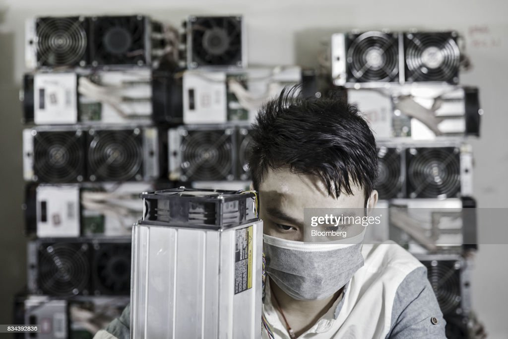 A technician makes repairs to bitcoin mining machines at a mining facility operated by Bitmain Technologies Ltd. in Ordos, Inner Mongolia, China, on Friday, Aug. 11, 2017. Bitmainis one of the leading producers of bitcoin-mining equipment and also runs Antpool, a processing pool that combines individual miners from China and other countries, in addition to operating one of the largest digital currency mines in the world. Photographer: Qilai Shen/Bloomberg via Getty Images