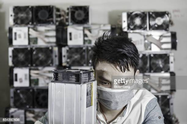 A technician makes repairs to bitcoin mining machines at a mining facility operated by Bitmain Technologies Ltd in Ordos Inner Mongolia China on...