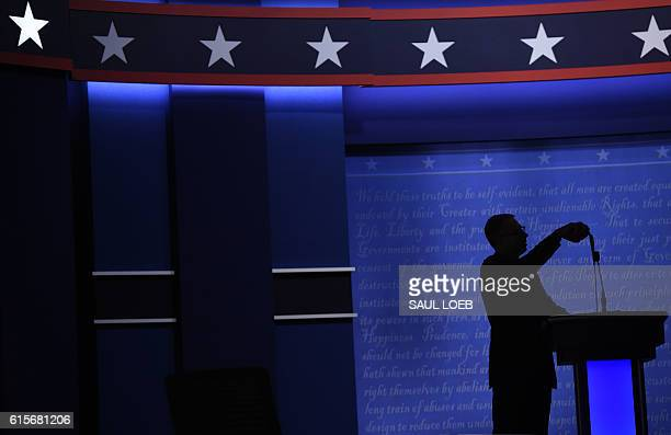 A technician measures the height of Donald Trump microphone before the final presidential debate at the Thomas Mack Center on the campus of the...