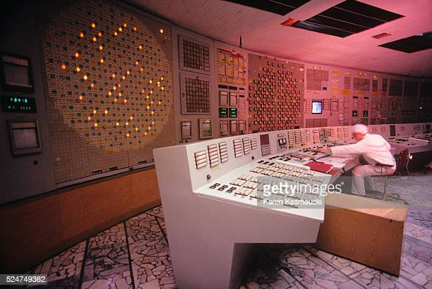 Technician monitoring nuclear power production in one of the undamaged reactors of the Chernobyl nuclear power complex. One of the reactors suffered...