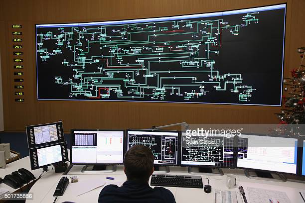 A technician monitors electricity levels in front of a giant screen showing the eastern German electricity transmission grid in the control center of...