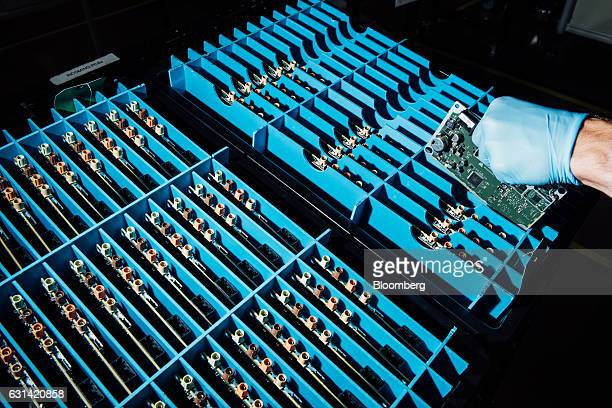A technician moves electronic components at the Magna International Inc office in Holly Michigan US on Friday Sept 9 2016 Magna the world's biggest...