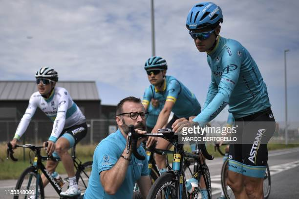 A technician of Astana Pro Team checks the bike of Danish rider Jakob Fuglsang during a training session of Kazakhstan's Astana Pro Team cycling team...