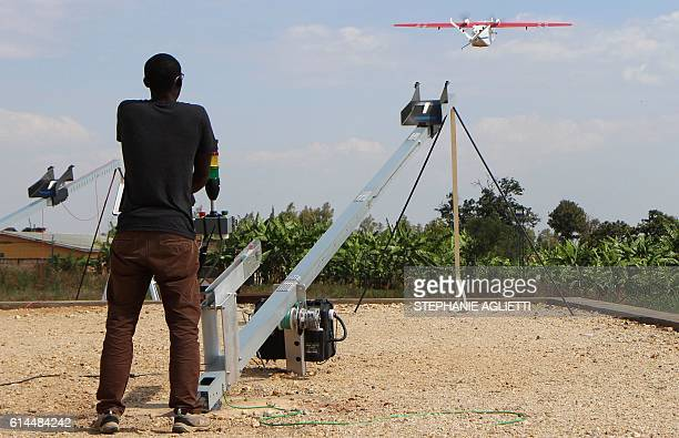 TOPSHOT A technician of Californiabased robotics company Zipline launches a drone on October 12 2016 in Muhanga 50 kilometres west of the capital...