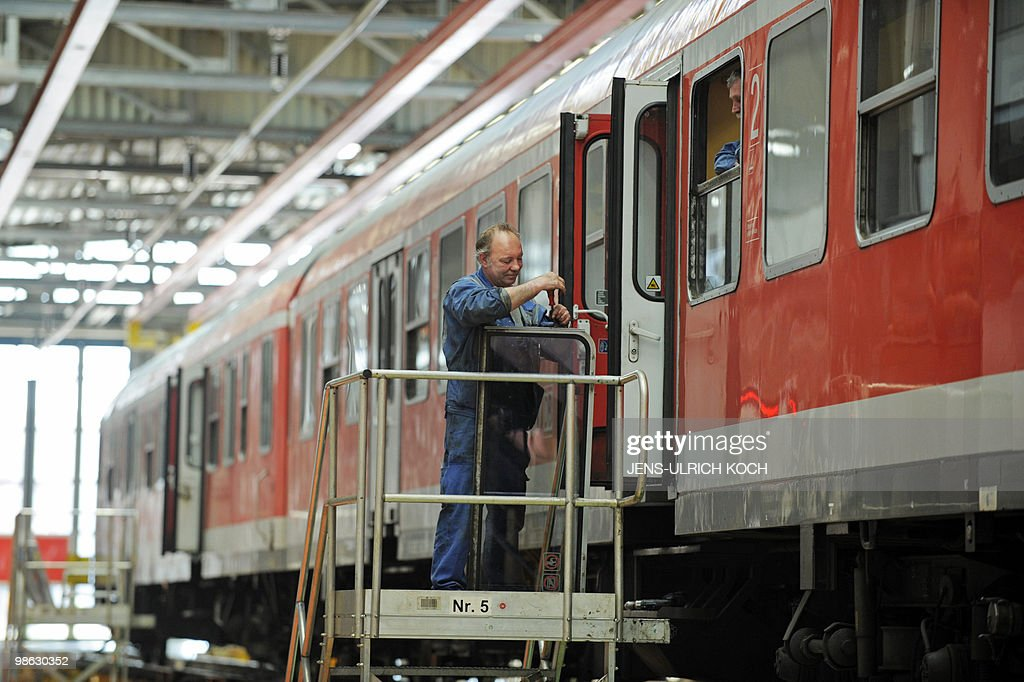 A technician of the DB Regio AG, a subsidiary of Germany's national rail company Deutsche Bahn, repairs the window of a railcar in the repair and assembling shop of the Deutsche Bahn in Erfurt, east-central Germany on April 23, 2010.