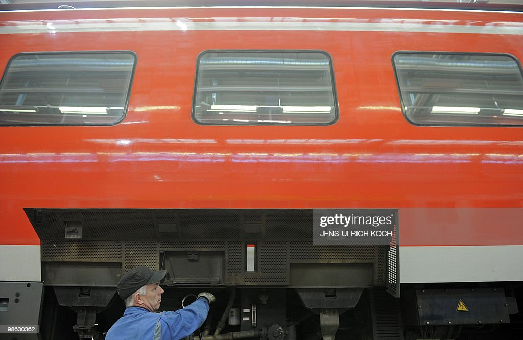 A technician of the DB Regio AG, a subsidiary of Germany's national rail company Deutsche Bahn, works on the regular inspection of a railcar in the repair and assembling shop of the Deutsche Bahn in Erfurt, east-central Germany on April 23, 2010.