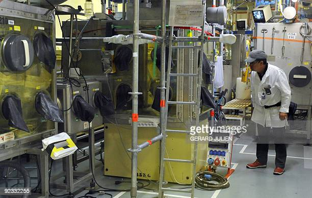 A technician of the French Atomic Energy Commission is pictured in the atelier de technologie du plutonium at the Cadarache nuclear research centre...