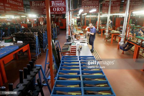 A technician of the stock department is seen at work on April 4 2019 at the Perazzi Armi factory in Botticino Mattina a village in the outskirt of...