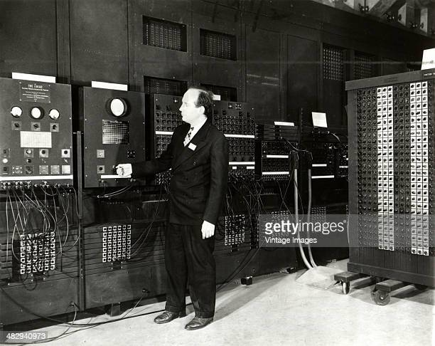 A technician operate the ENIAC or Electronic Numerical Integrator And Computer on the campus of the University of Pennsylvania Philadelphia...